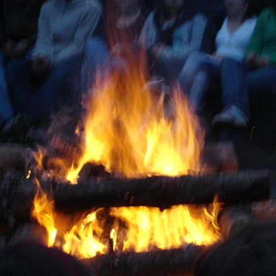 A campfire is just one of the benefits of staying in a RV park.