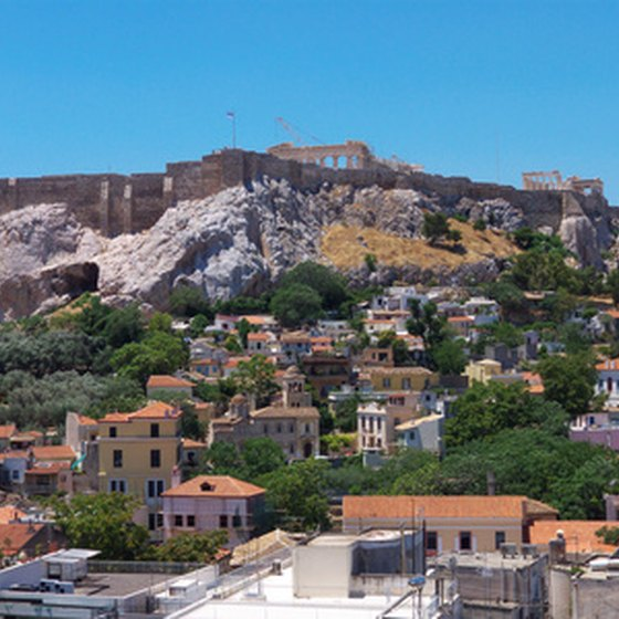 Many travelers enjoy visiting Greece's ancient ruins.