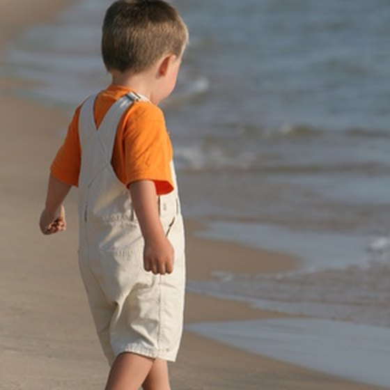 Playing on the shores of Lake Michigan provides a calm vacation experience for many families.