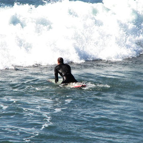 Beginners surf the calm waters at Mission and La Jolla, while experienced surfers head to Swami's.