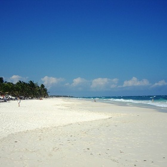 The white sand beaches of Cancun draw international vacationers.