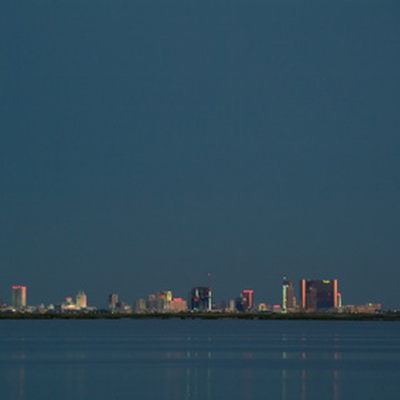 The casinos of Atlantic City light up the evening sky.