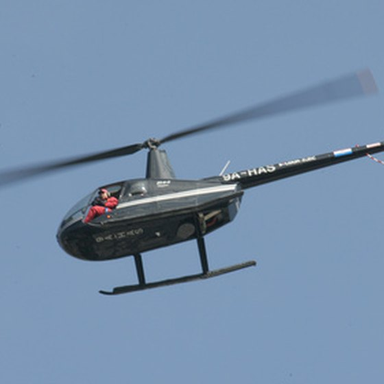 Helicopter flies overhead