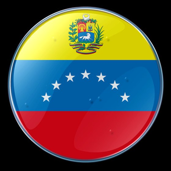 The Venezualan flag and coat of arms on a button.