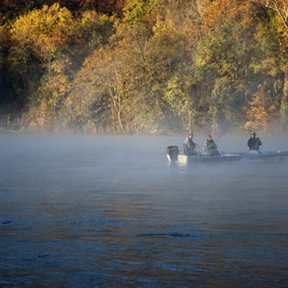 Boating and fishing are convenient at cabins on Arkansas rivers.