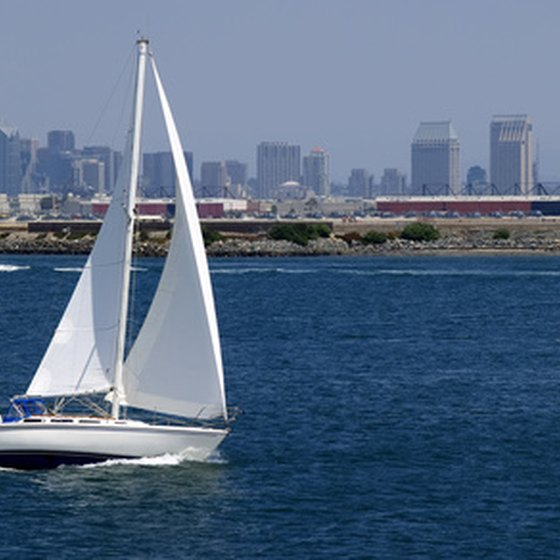 Visitors enjoy the sea breeze as they sail through San Diego Bay on a chartered boat