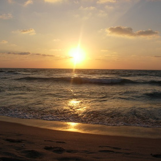 After playing golf, Sunset Beach vacationers can visit the beach to watch the sun set over the coast.