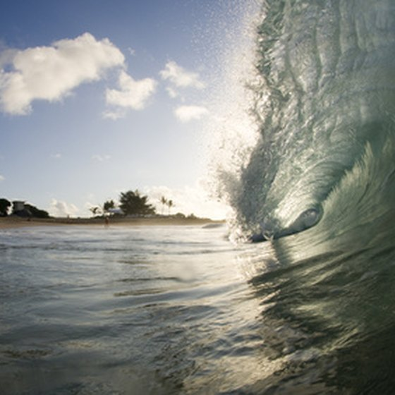 Surf and sand, such as this break on Oahu, are among the best free attractions in Hawaii.