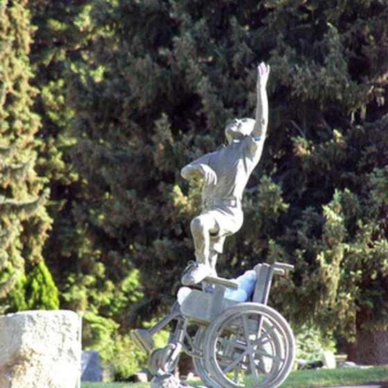 Statue of a child standing from a wheelchair.
