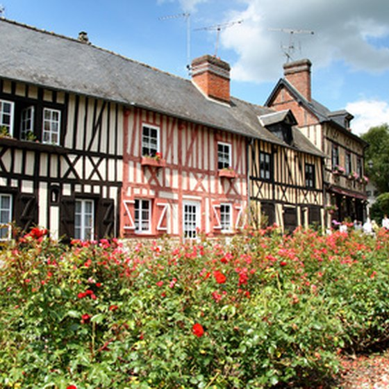 A row of traditional timber-framed cottages in Normandy.