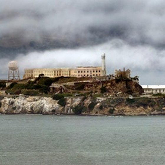 Morning Coastal Fog clears over Alcatraz Island in San Francisco.
