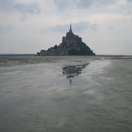 Mont Saint Michel rises from the tidal basin of the Gulf of St. Malo.