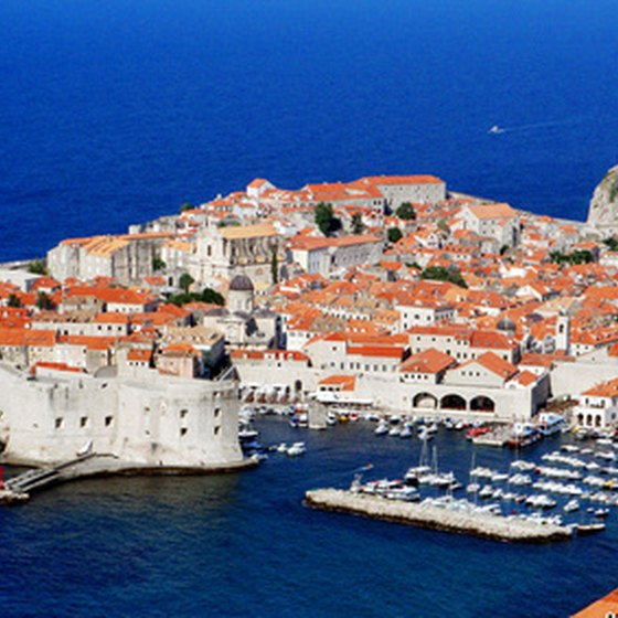 Tile rooftops and bright blue waters welcome visitors to Dubrovnik.