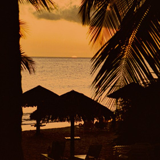 Catch sunsets from a private beach palapa year-round in Aruba.