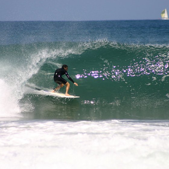 A surfer emerging from a pipe.
