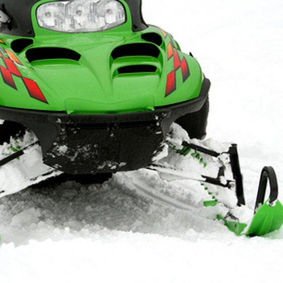 Enjoy Utah's light powder on a snowmobile.