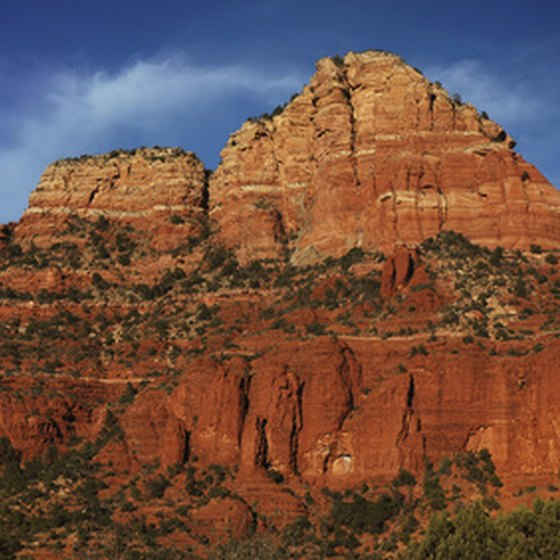 The towering Red Rocks of Sedona provide a majestic backdrop for visitors.