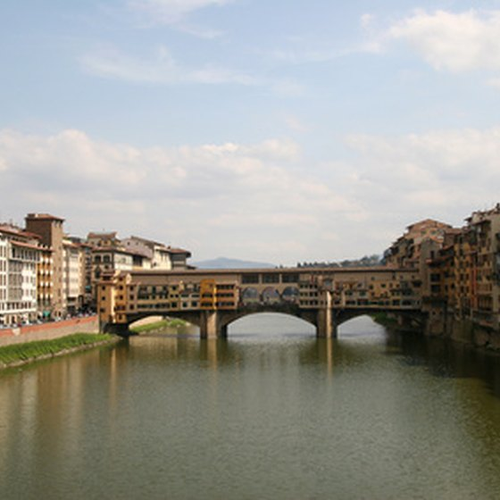 Walk across the Ponte Vecchio in Florence.