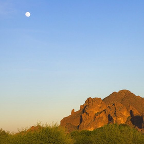 Red rock Camelback Mountain beckons climbers to scramble its technically challenging trails in mid-Phoenix.