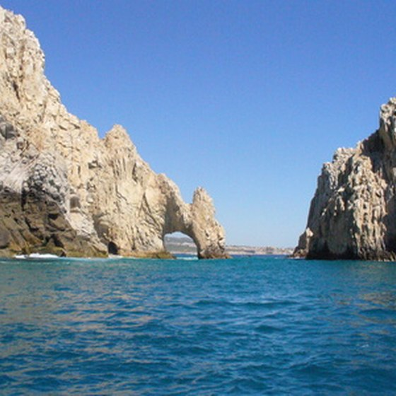 Lovers' Beach, just behind this arch, in Cabo San Lucas offers scenic views of the Land's End arch.