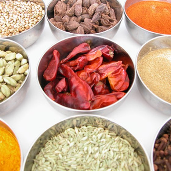 An array of spices goes into a typical Indian dish.