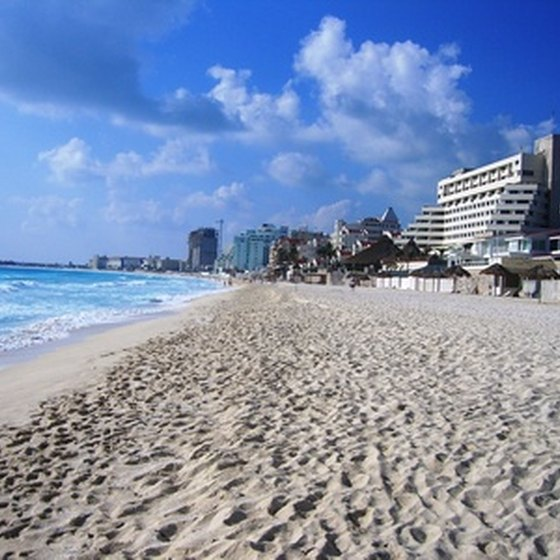 Honeymooners can relax on the white sandy shoreline of Cancun.