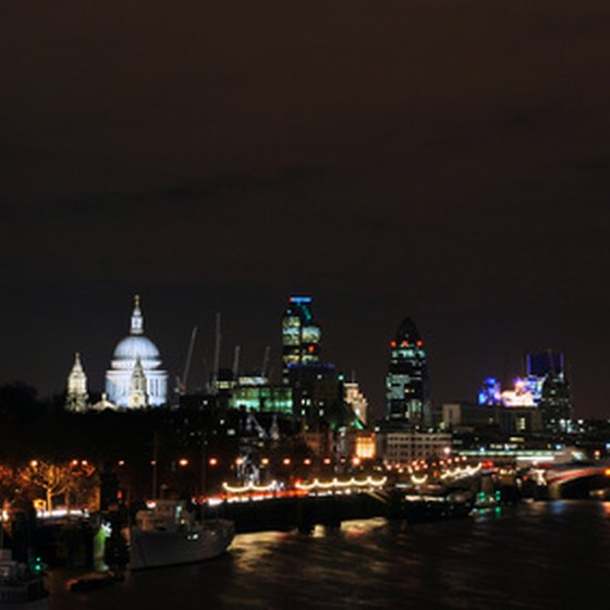 A romantic river cruise in London at night showcases the illuminated city.