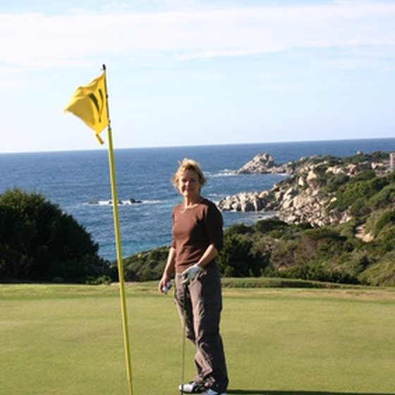 A golf enthusiast enjoys ocean views while playing a round of golf.