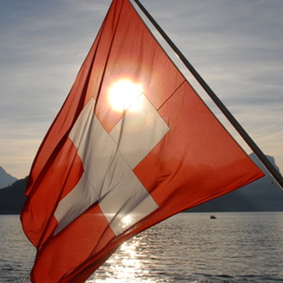 The Swiss flag with an Alpine backdrop