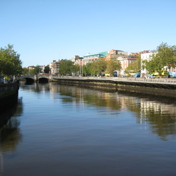 The Liffey River in Dublin features many shops, pubs and hotels on either side.