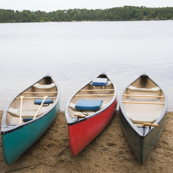 Canoeing is done on calm waters, usually lakes.