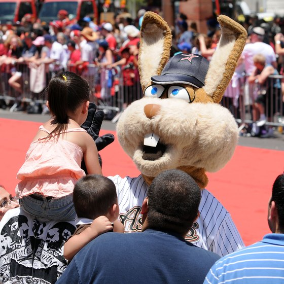 A Houston Astros mascot gives a high-five during a 2011 parade in Phoenix honoring baseball's All-Stars.