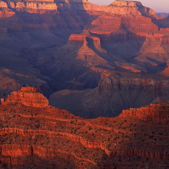 Sunrise and sunset highlight the rich colors of the Grand Canyon.
