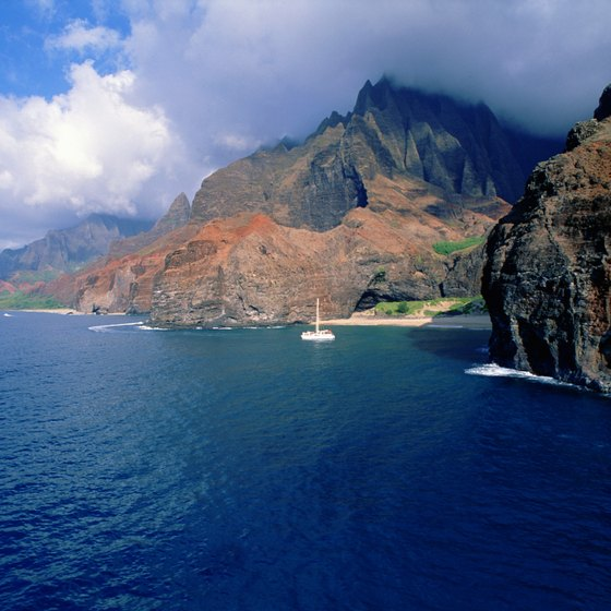 A snorkeling excursion via boat gives you glimpses of the stunning Na Pali coastline.
