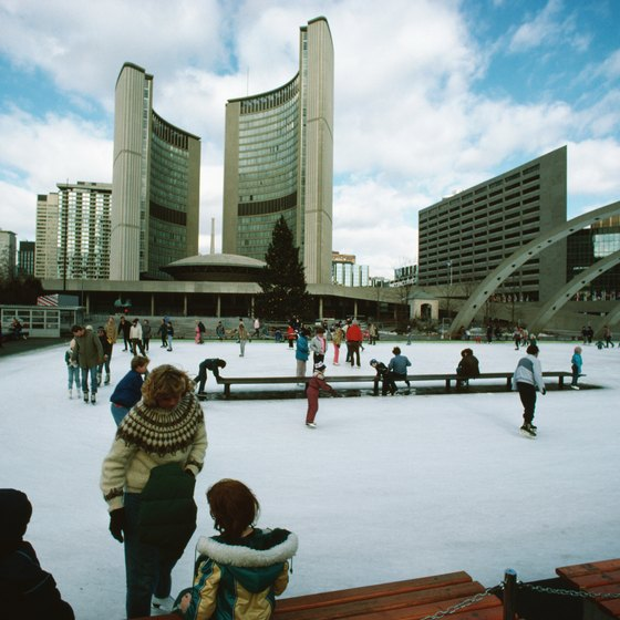 Ice skating by Toronto's town hall is a popular December pastime.