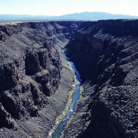 New Mexico has river gorges where you can run rapids.