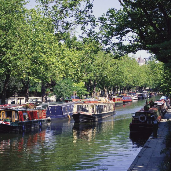 Little Venice is known for its colorful houseboats, many bedecked with flowers.