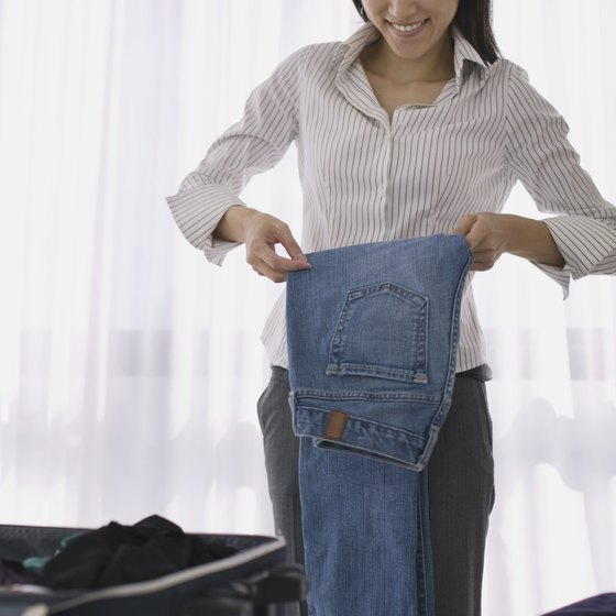 You can fold or roll jeans when packing.