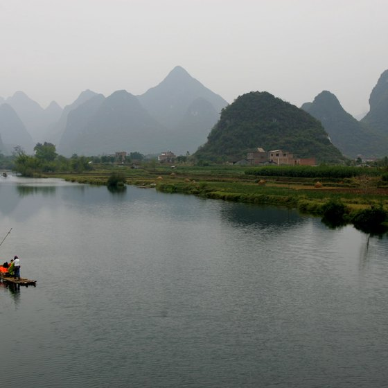 Riverboats take tourists along the Li River in Southern China.