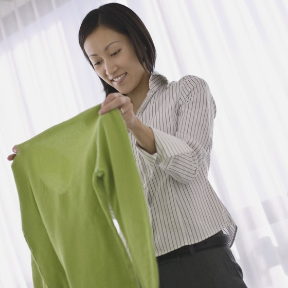 Stuff a garbage or grocery store bag in your garment bag to store soiled clothing.