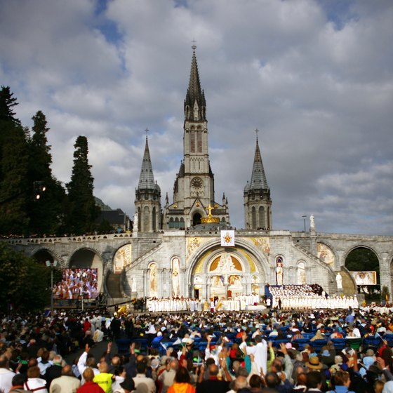 The faithful visist Lourdes, France, where Saint Bernadette saw an apparation of the Virgn Mary.