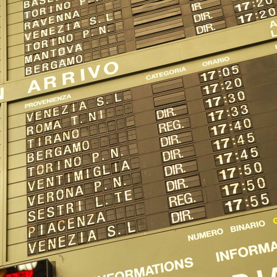 "The trains at the top of the information board under ""partenza"" are the upcoming departures."