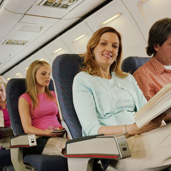 Sitting near an exit is just one of many factors that determine the safest seats on a airplane.