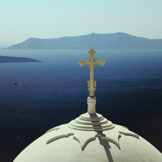 Santorini's capital, Fira, renowned for its Cycladic architecture, overlooks the Aegean Sea.