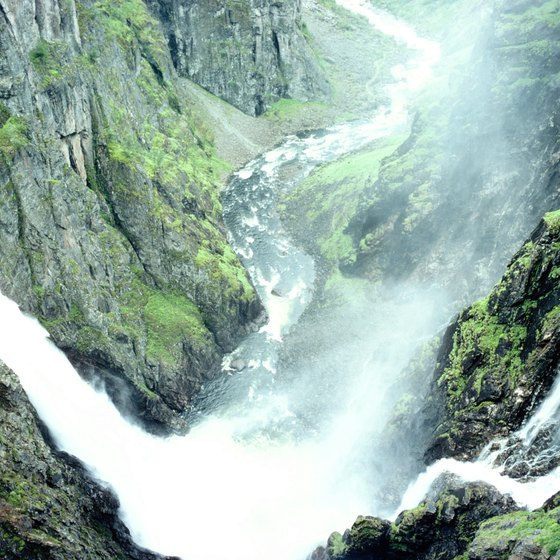 Tall cliffs and rushing waterfalls contribute to the drama of Norway's fjords.
