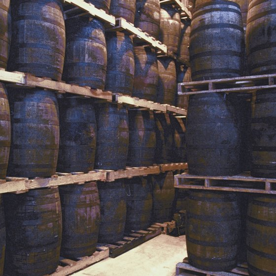 Whiskey is aged in large wooden barrels.