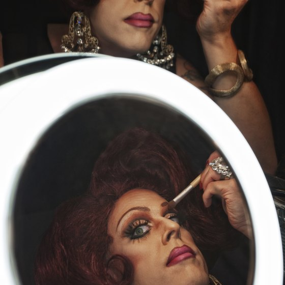 Performers spend hours turning masculine features into feminine ones.