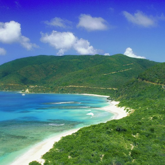 Rolling green hills bordering white sand on Savannah Beach is a favorite spot in the British Virgin Islands.