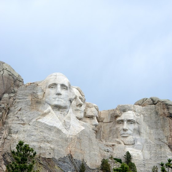 Head to Mount Rushmore in the evening to see the lighted memorial.