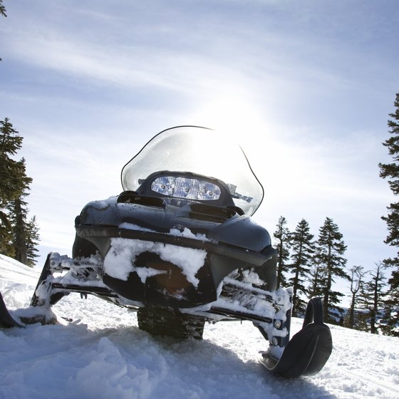 Explore miles of trail atop Grand Mesa by snowmobile.